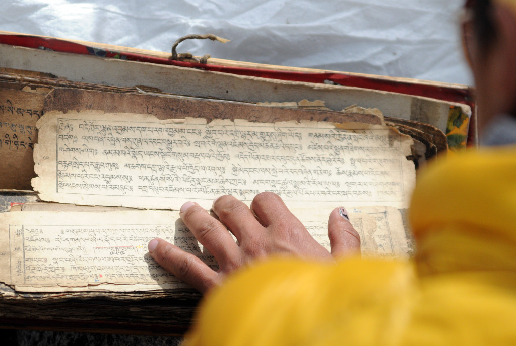Nepali monk with prayer book
